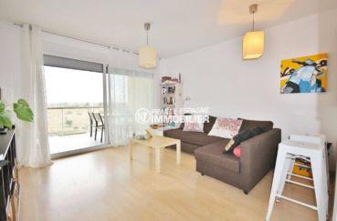 appartements a vendre a rosas, cave privée, salon / séjour accès terrasse de 10 m² vue canal