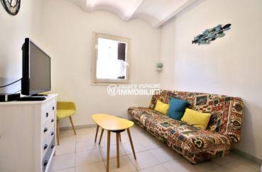 achat appartement rosas, bon investissement, salon / séjour avec canapé convertible