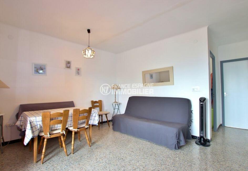 agence immobiliere costa brava: appartement 54 m², salon / séjour canapé convertible et coin repas