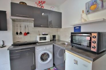vente empuriabrava: appartement 24 m², cuisine aménagée équipée avec rangements