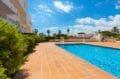 vente appartements rosas espagne, vue mer, aperçu de la piscine communautaire