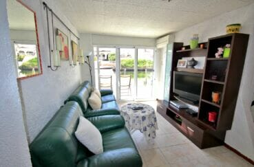 acheter appartement empuriabrava, appartement de 38 m², salon avec terrasse vue canal