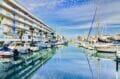 immo center rosas: appartement 3 pièces 58 m², canal de roses et ses bateaux amarrés