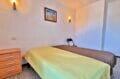 appartement à vendre roses espagne, 2 chambres 63 m², chambre avec armoire encastrée, appliques murales